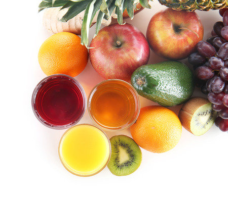Fresh fruits and glasses of juice on white background. Healthy food concept Stock fotó