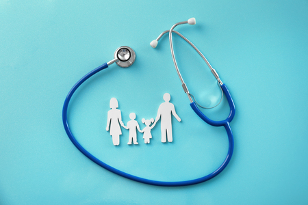 Family figure and stethoscope on color background. Health care concept 스톡 콘텐츠 - 113250382