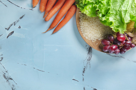 Wooden board with healthy food on table Stock Photo