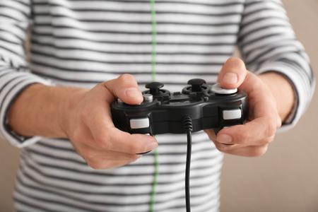 Young man with gamepad, closeup