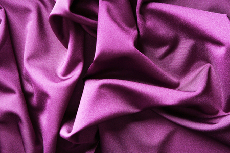 Purple fabric with folds, closeup
