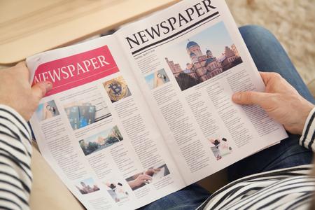Senior man reading newspaper at home Imagens