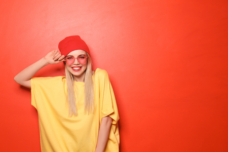 Attractive hipster girl on color background Stock fotó