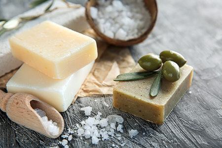 Bars of natural soap with olive extract and sea salt on table 版權商用圖片