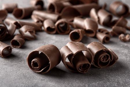 Chocolate curls on grey background, closeup Stock fotó