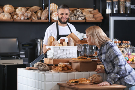 Young woman choosing pastries in bakery