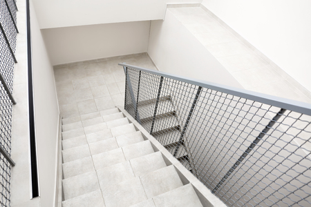 Stairs with metal railing indoors, view from CCTV camera Stock Photo