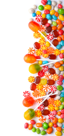 Tasty lollipops and colorful candies on white background