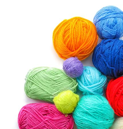 Set of knitting yarn on white background