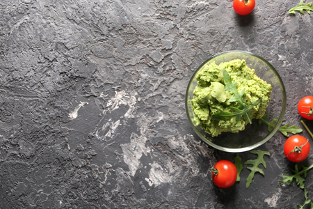 Fresh guacamole in glass bowl on table
