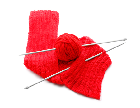 Knitting thread with scarf on white background Stock fotó