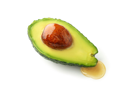 Half of fresh avocado on white background