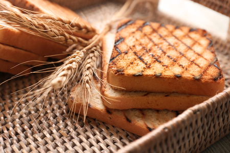 Wicker tray with toasted bread, closeup 스톡 콘텐츠