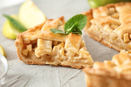 Tasty homemade apple pie on table, closeup