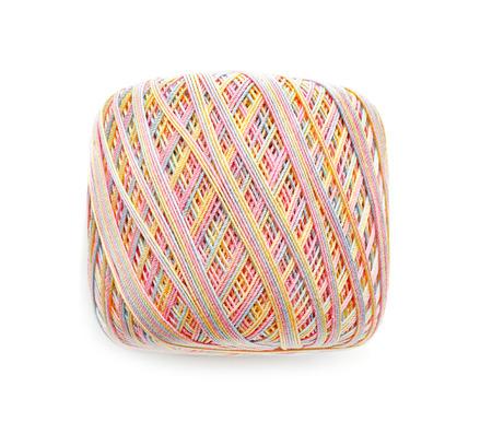 Ball of knitting thread on white background