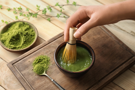 Woman preparing matcha tea, closeup Standard-Bild