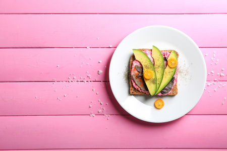 Delicious toast with avocado on plate
