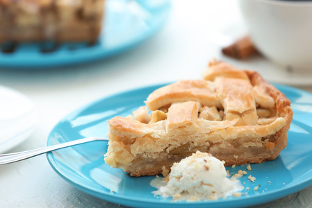 Plate with piece of tasty apple pie and ice-cream on table, closeup