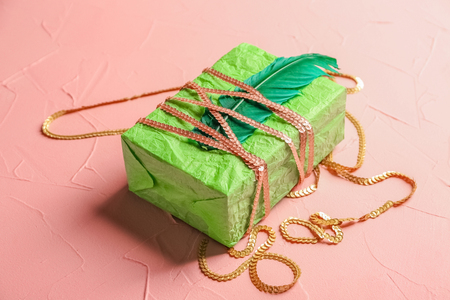 Stylish gift box on color background Banque d'images
