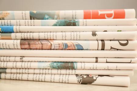 Pile of newspapers table, closeup Archivio Fotografico - 113846623