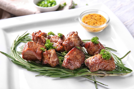 Barbecue skewers with juicy meat and herbs on plate