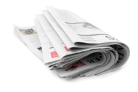 Folded newspapers on white background Banco de Imagens