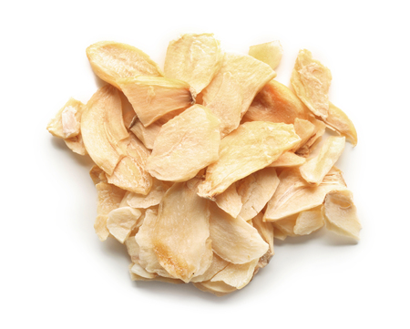 Dried garlic flakes on white background
