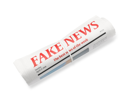 Rolled newspaper with headline FAKE NEWS on white background Banque d'images - 113992904