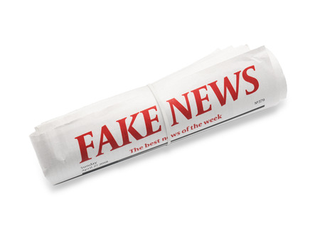 Rolled newspaper with headline FAKE NEWS on white background Banque d'images - 113993084
