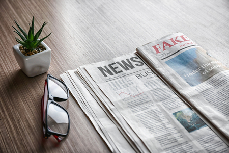 Morning newspapers on wooden background Banco de Imagens