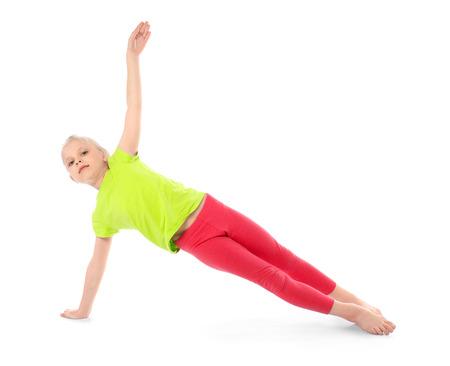 Little girl practicing yoga on white background Foto de archivo
