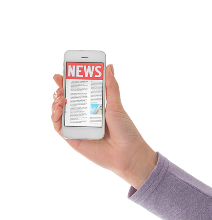 Woman holding phone with news on screen against white background