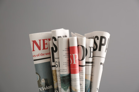 Newspapers on grey background