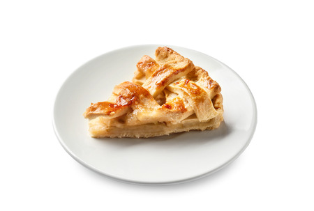 Piece of tasty homemade apple pie on white background 免版税图像
