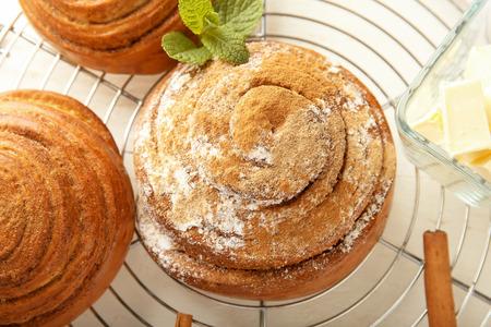 Sweet cinnamon buns on cooling rack, closeup
