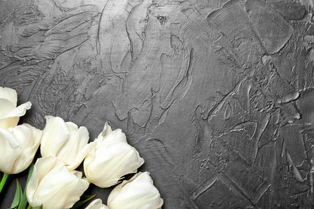 Beautiful tulips on dark textured background