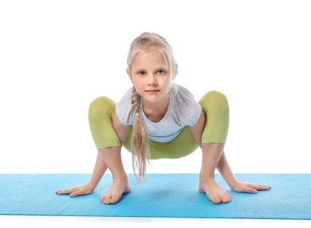 Little girl practicing yoga on white background Stockfoto