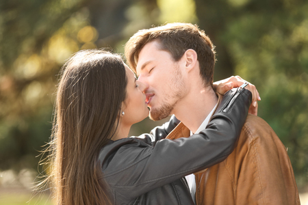 Young lovely couple kissing outdoors