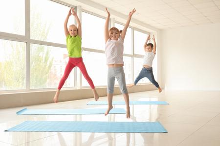 Little children training indoors Stock Photo