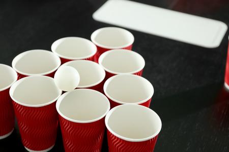 Set for beer pong game on table Foto de archivo