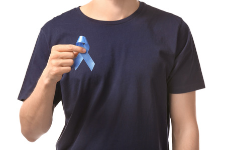 Man holding blue ribbon on white background. Prostate cancer concept