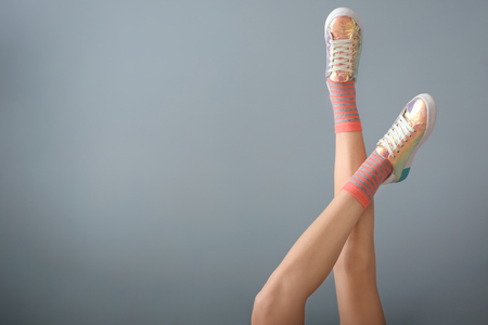 Legs of beautiful young woman on color background 스톡 콘텐츠