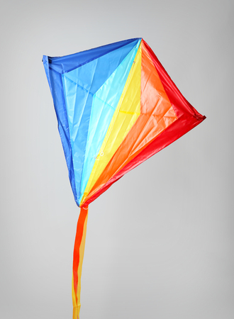 Colorful kite on light background Banque d'images