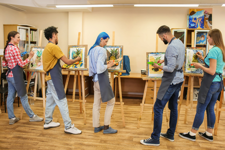 Art students painting in workshop 版權商用圖片