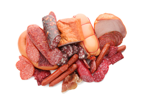 Assortment of delicious deli meats on white background