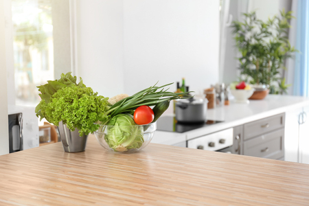 Fresh vegetables on wooden table in kitchen Stock Photo
