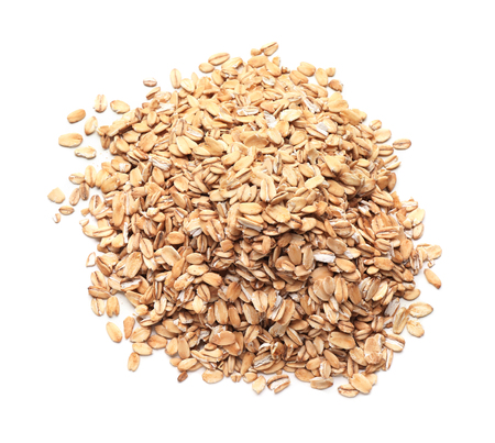 Heap of raw oatmeal on white background