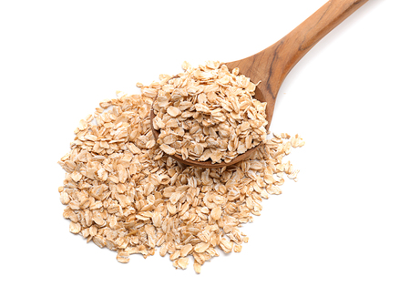 Spoon with raw oatmeal on white background 版權商用圖片