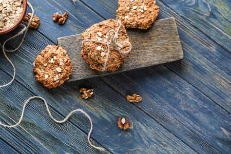 Composition with delicious oatmeal cookies on wooden background