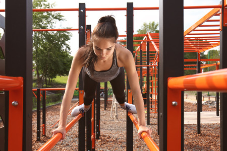 Sporty young woman training on athletic field Foto de archivo